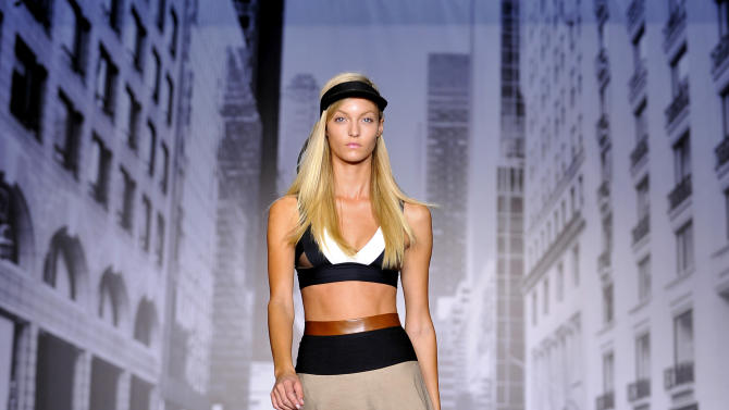 The DKNY Spring 2013 collection is modeled during Fashion Week in New York on Sunday, Sept. 9, 2012. (AP Photo/Stephen Chernin)