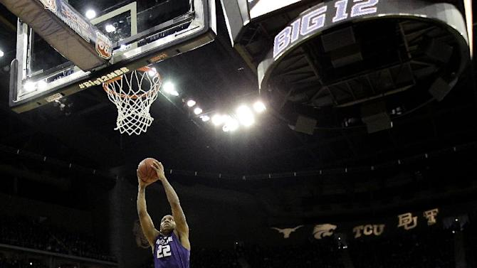 Kansas State guard Rodney McGruder (22) gets past Kansas guard Elijah Johnson (15) to put up a shot during the first half of the championship NCAA college basketball game of the Big 12 men's tournament Saturday, March 16, 2013, in Kansas City, Mo. (AP Photo/Charlie Riedel)