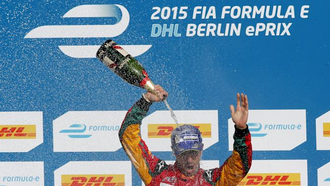 Audi Sport ABT driver Di Grassi of Brazil sprays champagne on the podium after winning the Formula E Championship race at the former Tempelhof airport in Berlin