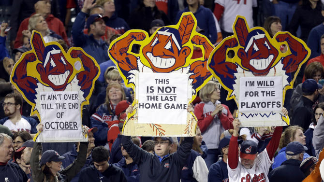 Cleveland Indians fans cheer after the Indians defeated the Chicago White Sox 7-2 in a baseball game on Wednesday, Sept. 25, 2013, in Cleveland. (AP Photo/Tony Dejak)