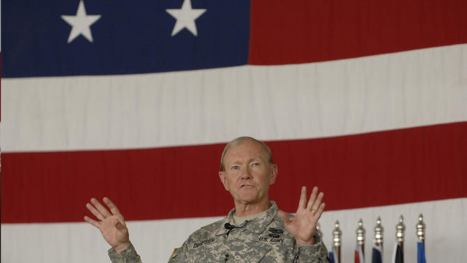 Army Gen. Martin Dempsey, the chairman of the Joint Chiefs of Staff, visits with airmen at Minot airforce base in Minot, N.D., on Monday, June 17, 2013. (AP Photo/Will Kincaid)