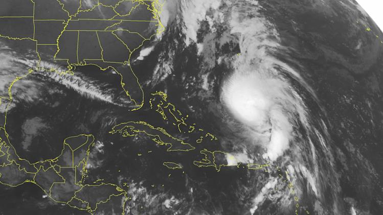 This NOAA satellite image taken Tuesday, Oct. 16, 2012 at 1:45 a.m. EDT shows Hurricane Rafael moving northward between Bermuda and Hispaniola. (AP Photo/Weather Underground)