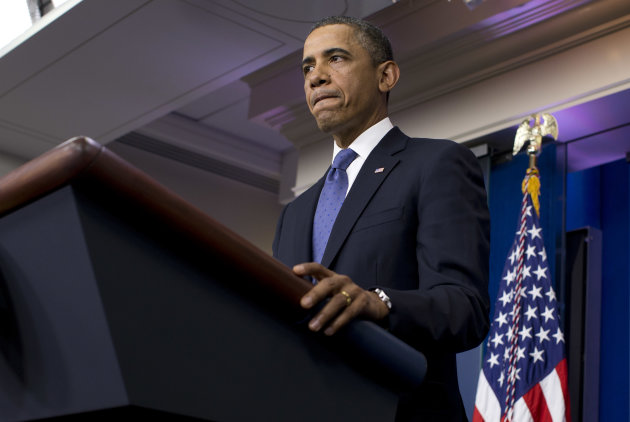 President Barack Obama pauses during a statement on the fiscal cliff negotiations with congressional leaders in the briefing room of the White House on Friday, Dec. 28, 2012 in Washington. The negotiations are a last ditch effort to avoid across-the-board first of the year tax increases and deep spending cuts. (AP Photo/ Evan Vucci)