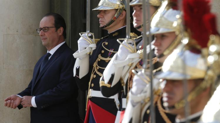 French President Hollande waits for guests before a meeting with European Socialist leaders at the Elysee Palace in Paris