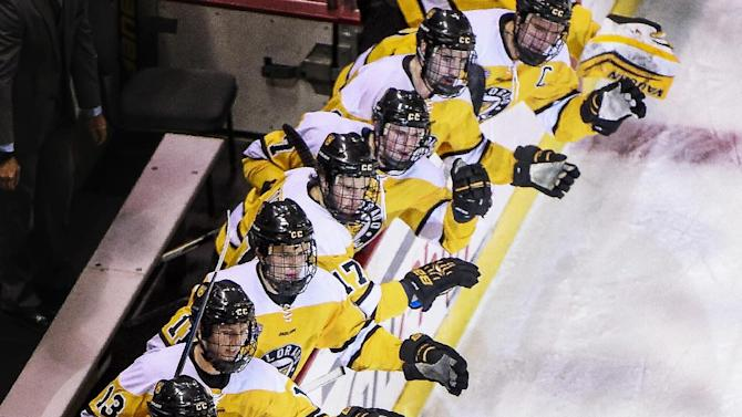 Colorado College left wing Scott Wamsganz high fives his teammates after scoring a goal in the second period of an NCAA college hockey game against Wisconsin in Colorado Springs, Colo., Friday, Nov. 21, 2014. (AP Photo/The Colorado Springs Gazette, Michael Ciaglo)