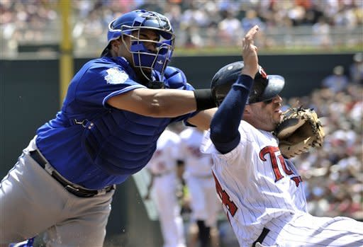 Mauer, De Vries lead Twins past KC for DH sweep