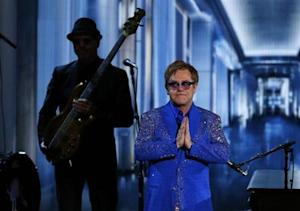 "Musician Elton John reacts after performing ""Home Again"" in a musical tribute to Liberace at the 65th Primetime Emmy Awards in Los Angeles"