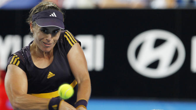 Spain's Anabel Medina Garrigues hits a return to Serbia's Ana Ivanovic during the women's final at the Hopman Cup tennis tournament in Perth, Australia, Saturday Jan. 5, 2013.  Garrigues won the match 6-4 6-7 6-2. (AP Photo/ Theron Kirkman)
