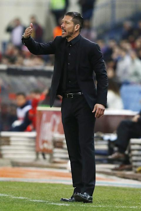 Atletico's coach Diego Simeone from Argentina, talks to his players during a Spanish La Liga soccer match between Atletico Madrid and Espanyol at the Vicente Calderon stadium in Madrid, Spain, Sat