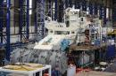 Employees of Soil Machine Dynamics work on a subsea mining machine being built for Nautilus Minerals at Wallsend