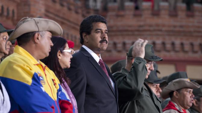Venezuela's interim President Nicolas Maduro attends a ceremony marking the Day of the National Revolutionary Militia, also called Bolivarian militias,  in Caracas, Venezuela, Saturday, April 13, 2013. The Bolivarian Militia is a force of volunteers ranging from students to retirees formed by the late President Hugo Chavez. Just over a month after Chavez succumbed to cancer, Venezuelans vote Sunday to replace him. Maduro, who served as Chavez's foreign minister and vice president, is running against opposition candidate Henrique Capriles in Sunday's vote.(AP Photo/Ramon Espinosa)
