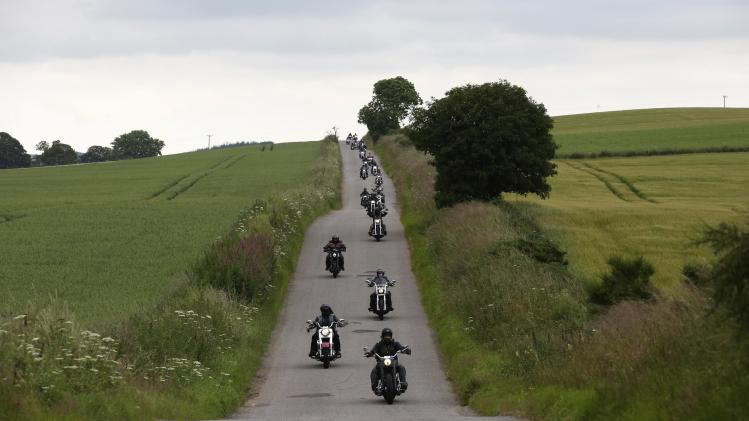 Harley Davidson enthusiasts ride through the Angus countryside, Scotland