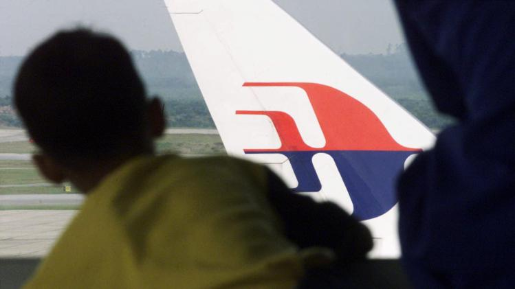 File picture of a boy looking at a Malaysian Airlines plane at the Kuala Lumpur International Airport in Sepang