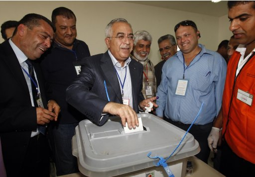 Palestinian Prime Minister Salam Fayyad casts his vote in the West Bank village of Der Alghson near Tulkarm