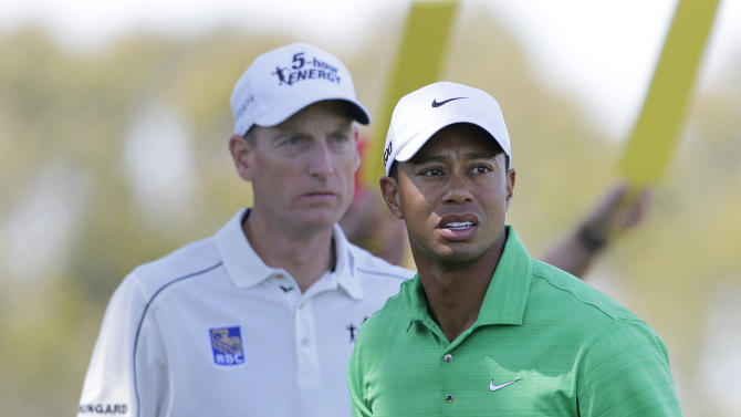 Jim Furyk and Tiger Woods are seen on the second tee during the third round of the U.S. Open Championship golf tournament Saturday, June 16, 2012, at The Olympic Club in San Francisco. (AP Photo/Eric Gay)