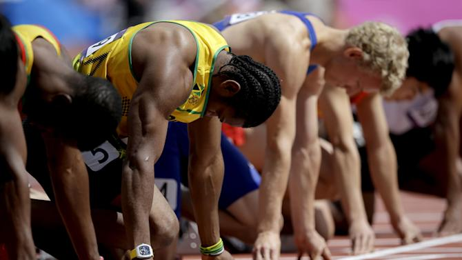 Jamaica's Yohan Blake, second left, starts in a men's 100-meter heat during the athletics in the Olympic Stadium at the 2012 Summer Olympics, London, Saturday, Aug. 4, 2012. (AP Photo/Matt Slocum)