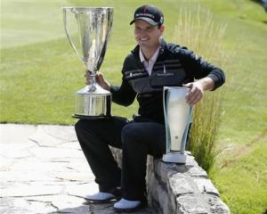 \Zach Johnson of U.S.poses after winning BMW Championship golf tournament at Conway Farms Golf Club in Lake Forest,