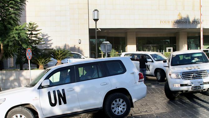 A convoy of chemical weapons disarmament experts depart the Four Seasons Hotel in Damascus, Syria, Tuesday, Oct. 8, 2013. The joint OPCW-U.N. mission to scrap Syria's chemical program stems from a deadly Aug. 21 attack on opposition-held suburbs of Damascus in which the U.N. has determined the nerve agent sarin was used. Hundreds of people were killed, including many children.(AP Photo)