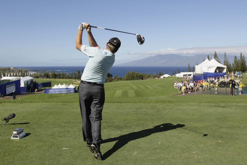 Michael Bradley hits from the first tee during the first round of the Hyundai Tournament of Champions PGA Tour golf tournament in Kapalua, Hawaii, Friday, Jan. 6, 2012. (AP Photo/Eric Risberg)