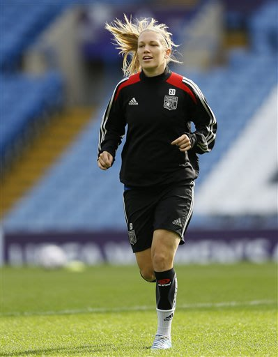 Lyon's Lara Dickenmann of Switzerland runs during a training session at Stamford Bridge Stadium in London Wednesday, May 22, 2013. VfL Wolfsburg will play Olympique Lyonnais in the Women's Champions L