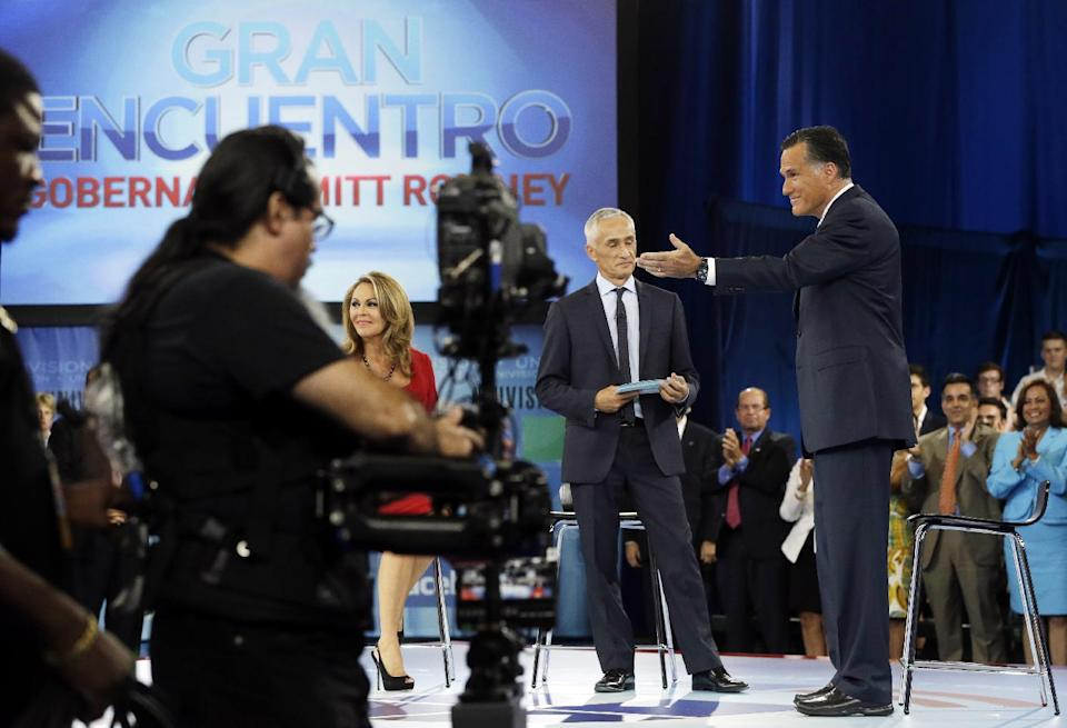 "Republican presidential candidate and former Massachusetts Gov. Mitt Romney participates in a Univision ""Meet the Candidates"" forum with Jorge Ramos and Maria Elena Salinas in Coral Gables, Fla., Wednesday, Sept. 19, 2012.  (AP Photo/Charles Dharapak)"