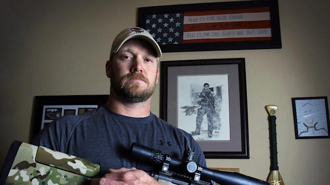 "FILE - In this April 6, 2012 file photo, Chris Kyle, a former Navy SEAL and author of the book ""American Sniper,"" poses in Midlothian, Texas. Kyle and his friend Chad Littlefield were fatally shot at a shooting range southwest of Fort Worth, Texas, on Saturday, Feb. 2, 2013. Former Marine Eddie Ray Routh, who came with them to the range, has been arrested for the murders. (AP Photo/The Fort Worth Star-Telegram, Paul Moseley, File)"