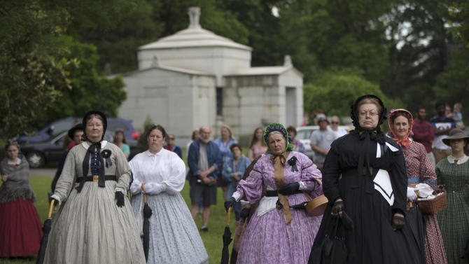 Members of the Ladies Living History Society attend a Memorial Day ceremony in honor of soldiers who died in the Civil War, Monday, May 25, 2015, at Spring Grove Cemetery in Cincinnati. The cemetery is the final resting place for thousands of fallen Civil War soldiers. (AP Photo/John Minchillo)