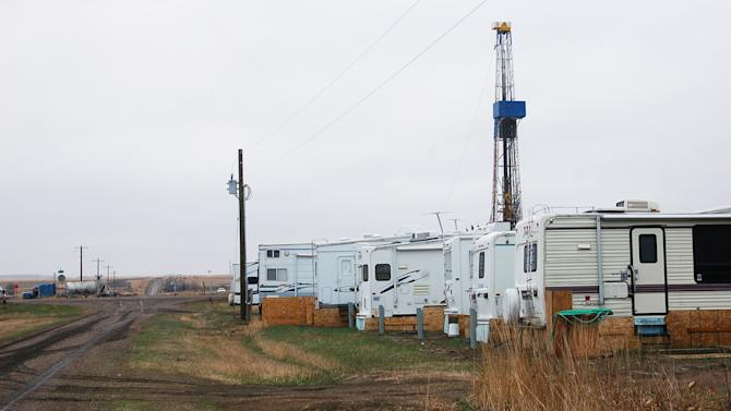 In this April 19, 2012, photo trailers used as temporary housing for oil industry workers are are parked along a dirt road outside Dore, N.D. The western North Dakota town has seen an economic and population turnaround with increased oil activity in the region. (AP Photo/ James MacPherson)