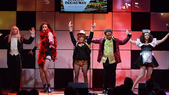"""IMAGE DISTRIBUTED FOR ALZHEIMER'S ASSOCIATION - From left, actors Simon Helberg, Jim Parsons, Melissa Rauch, Johnny Galecki and Kaley Cuoco, from the cast of """"The Big Bang Theory,"""" perform onstage at the 21st Annual 'A Night at Sardi's' to benefit the Alzheimer's Association at the Beverly Hilton Hotel on Wednesday, March 20, 2013 in Beverly Hills, Calif. (Photo by Jordan Strauss/Invision for Alzheimer's Association/AP Images)"""