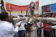 Activists of Bhagwan Valmiki Shakti Sena shout slogans against the film Jism 2 (Body 2), as they burn an effigy of actress Sunny Leone and director Pooja Bhatt during a demonstration in Amritsar, on July 31. The demonstrators protested &#39;against vulgarity&#39; shown in the Bollywood film