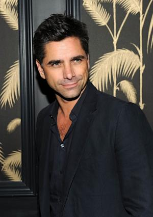 John Stamos smiles for the camera at the after party for the Cinema Society's screening 'Killer Joe' at No. 8 in New York on July 23, 2012 -- Getty Images