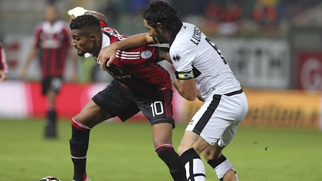 AC Milan's Kevin Prince Boateng (L) is challenged by Parma's Alessandro Lucarelli during their Serie A soccer match at the Tardini stadium in Parma September 29, 2012 (Reuters)