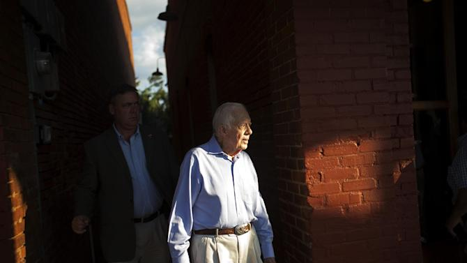 FILE - In this Aug. 22, 2015 file photo, former President Jimmy Carter leaves a reception in his hometown of Plains, Ga. Carter's recent diagnosis that cancer has spread to his brain will require him to scale back his work, but Carter Center officials say their programs will continue uninterrupted.   (AP Photo/David Goldman)