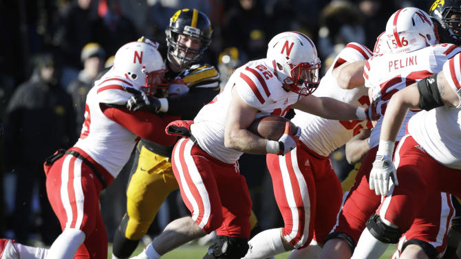 Nebraska running back Rex Burkhead (22) carries the ball during the second half of an NCAA college football game against Iowa, Friday, Nov. 23, 2012, in Iowa City, Iowa. Nebraska won 13-7. (AP Photo/Charlie Neibergall)