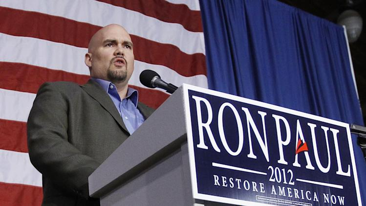 In this Dec. 28, 2011, file photo, Iowa State Senator Kent Sorenson speaks at a rally for Republican presidential candidate, Rep. Ron Paul, R-Texas, at the Iowa State Fair Grounds in Des Moines, Iowa. Sorenson resigned from office Wednesday, Oct. 3, 2013, after investigator Mark Weinhardt's report concluded Sorenson likely broke ethics rules in receiving $7,500 in monthly income from Rep. Michelle Bachmann's, R-Minn., political action committee and presidential campaign in exchange for working as Bachmann's state chair in 2011. The state senator received a $25,000 check from a high-ranking official in Ron Paul's presidential campaign days before ditching Michele Bachmann to support Paul, and eventually received $73,000 in payments that may be linked to Paul's campaign, the independent investigator has found. (AP Photo/Charles Dharapak, file)