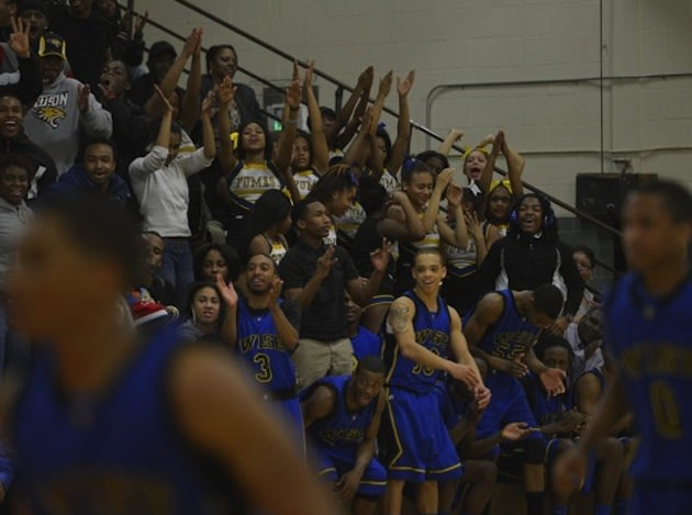 DuVal High fans react during an upset of rival Wise High in Maryland's Class 4A boys basketball regional semifinals -- Washington Post
