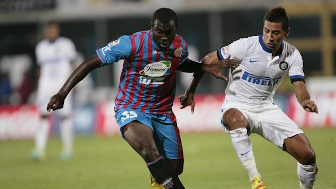 Catania's forward Souleymane Doukara (left) vies for the ball with Milan's midfielder Safir Taider during their Italian Serie A match at the Massimino Stadium in Catania on September 1, 2013