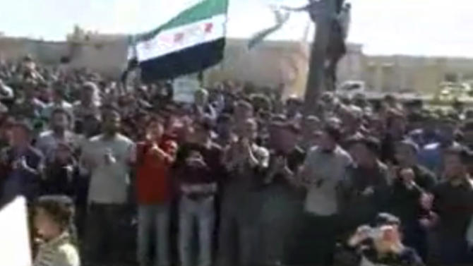 This image made from amateur video and released by Shaam News Network Thursday, March 15, 2012 purports to show a protest in Idlib, Syria. (AP Photo/Shaam News Network via APTN) THE ASSOCIATED PRESS CANNOT INDEPENDENTLY VERIFY THE CONTENT, DATE, LOCATION OR AUTHENTICITY OF THIS MATERIAL. TV OUT