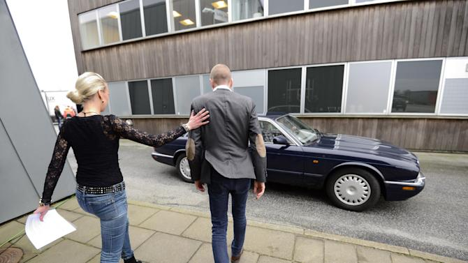 Former Rabobank and Christina Watches rider, Michael Rasmussen, right, accompanied by team owner, Christina Hembo, left, leaves a press conference in Herning, Denmark, Thursday Jan. 31. 2013. In the latest doping scandal to hit the sport of cycling since Lance Armstrong's confession earlier this month, Danish rider Michael Rasmussen admitted on Thursday that he took performance-enhancing drugs for more than a decade. Rasmussen said he took everything from testosterone and growth hormones to blood transfusions from 1998-2010 in an effort to boost his performance. The 38-year-old Dane said he would quit the sport immediately and cooperate with anti-doping agencies. (AP Photo/Polfoto, Claus Bonnerup) DENMARK OUT