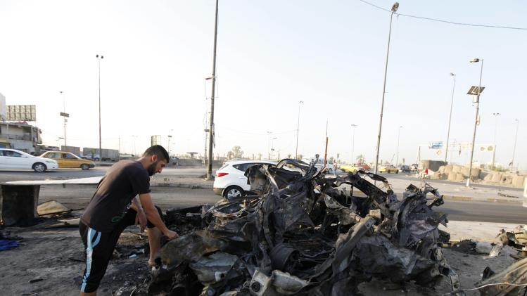A man stands near the site of a car bomb attack in Baghdad