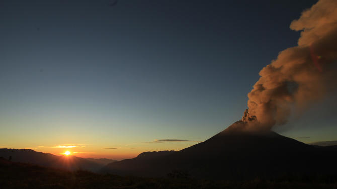 Ash and steam billow from the Tungurahua volcano, seen from Huambalo, Ecuador, as the sun rises early Tuesday, Aug. 21, 2012. (AP Photo/Dolores Ochoa)