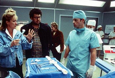 Soap Opera Consultant Shelly Curtis and director Neil LaBute discuss a scene with Greg Kinnear on the set of USA Films' Nurse Betty