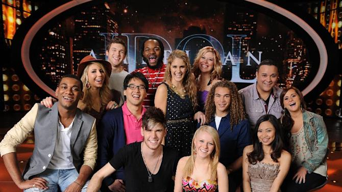 """In this March 1, 2012 image released by Fox, the remaining 13 contestants from the singing competition series, """"American Idol,"""" are shown in Los Angeles. (AP Photo/Fox, Michael Becker)"""