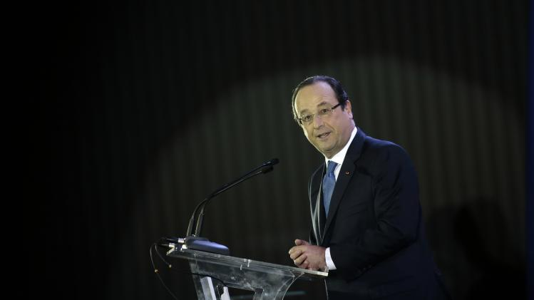 France's President Hollande speaks during meeting with Brazil's Education Minister Mercadante and students to discuss educational exchanges between the two countries, in Brasilia