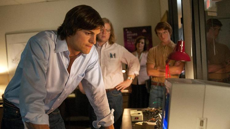 "This film image released by Open Road Films shows Ashton Kutcher as Steve Jobs in a scene from ""Jobs."" (AP Photo/Open Road Films, Glen Wilson)"