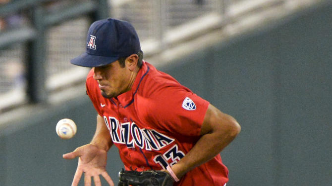Arizona shortstop Alex Mejia fields a ball hit by UCLA's Trevor Brown in the fifth inning of an NCAA College World Series baseball game in Omaha, Neb., Sunday, June 17, 2012. Brown was thrown out. (AP Photo/Ted Kirk)
