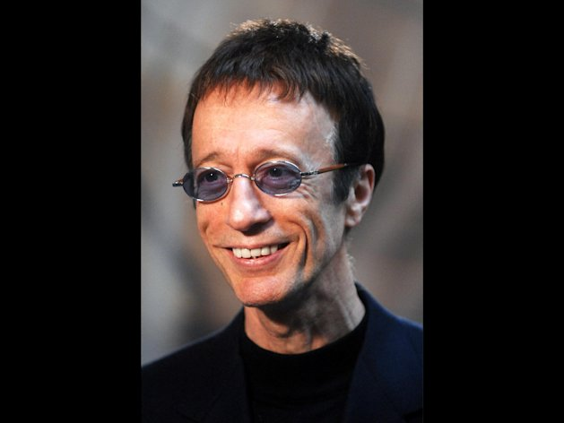 FILE - This Wednesday April 11, 2007 file photo shows Bee Gees singer Robin Gibb as he talks with journalists at the European Parliament in Brussels. Robin Gibb's spokesman said on Saturday April 21, 2012 the Bee Gees star has woken from a coma and is showing signs of recovery. (AP Photo/Geert Vanden Wijngaert, File)