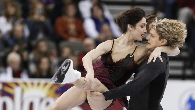 Meryl Davis and Charlie White compete in the senior pairs free dance program at the U.S. figure skating championships in Omaha, Neb., Saturday, Jan. 26, 2013. (AP Photo/Nati Harnik)