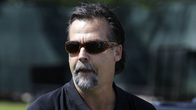 Former Tennessee Titans head coach Jeff Fisher talks with reporters at the Detroit Lions NFL football training camp Wednesday, Aug. 10, 2011, in Allen Park, Mich. Fisher has been in Detroit visiting former assistant coaches, including current Detroit Lions head coach Jim Schwartz, as well as his son, Brandon, who was hired as a defensive assistant this summer.  (AP Photo/Paul Sancya)