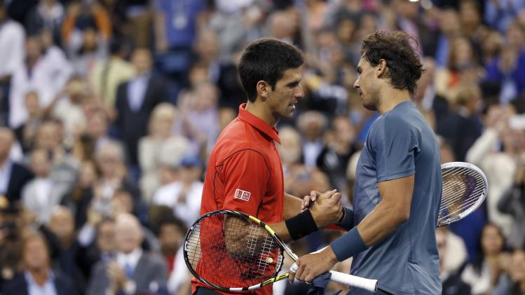 Nadal of Spain is congratulated by Djokovic of Serbia after his victory in their men's final match at the U.S. Open tennis championships in New York
